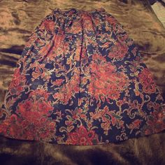 Vintage Paisley/Floral Silk Midi Skirt Vintage Midi Paisley/Floral skirt with waist side pockets.  Button closure with elastic on back waistline.  No size but fits like size 6. Vintage Skirts Midi