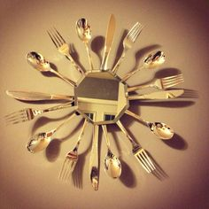 Kitchen mirror wall art- super easy dollar store project- dollar store mirror and a pack of silver plastic ware