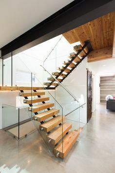 Modern Wood Staircase With Railing Glass Cream Polished Concrete Midori Uchi House Design Green Home Interior Design Brown Comfy Sofa White Wall: Midori Uchi - Award-Winning High-Class Ultra Green House Design in Canada