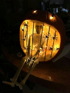 Skeleton in jail carved pumpkin lit with battery operated LED spider lights. Painted skewers black for prison bars. Skeleton in jail carved pumpkin lit with battery operated LED spider lights. Painted skewers black for prison bars. Disney Halloween, Diy Halloween Decorations, Holidays Halloween, Halloween Crafts, Halloween Cubicle, Easy Pumpkin Carving, Carving Pumpkins, Halloween Pumpkin Designs, Halloween Pumpkins
