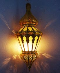 Hand hammered Brass Moroccan Lampin traditional Fez style with Tiffany frosted glass inserts.   This Moroccan Lamp with its beautiful shape and cutouts design will definitely add that special Moroccan flair that any of your rooms will truly appreciate!   Measures 25