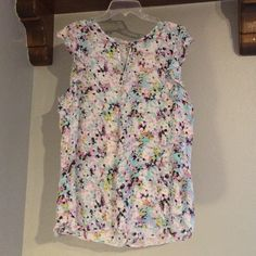 Colorful Top Colorful top. Worn a handful of times. Great condition. Very bright and springy. Super cute top with ruffle sleeves. Thin and light weight. Has a clamp closer on the top back. 100% Polyester. Tops Blouses