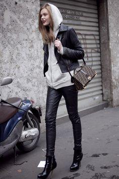 Frida Gustavsson wearing a hoodie under a cropped biker jacket.