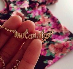 Bethany Mota ''motavator'' necklace!!!! get a free one if you buy something from her spring clothing line!!!!! :)