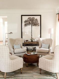 We love the eye-catching, graphic wall art as the focal point of this sweet neutral living room