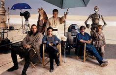 "Star Wars ""Knights in Tunisia"" from left:   Liam Neeson, the creature Jar Jar Binks, Natalie Portman, Ewan McGregor, R2-D2, George Lucas, C-3PO, and Jake Lloyd photo by Annie Leibovitz on The Phantom Menace set in North Africa for Vanity Fair  February 1999"