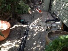 A second three way valve directs the greywater to the front or back