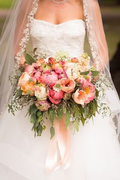 Thorne & Thistle designed this peachy-pink bouquet, made up of peonies, tulips, roses, and greenery. | Photo by Candace Nelson