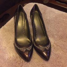Brown dress heels These fantastic dress shoes are the perfect addition to any business woman's closet! Brown patent leather style with brown houndstooth pattern down the sides adds plenty of dimension. Worn one time to a wedding. Bandolino Shoes Heels
