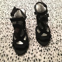 Black heels Size 6 1/2. Never been worn. Not made for people with narrow feet! LimeLight Shoes Heels
