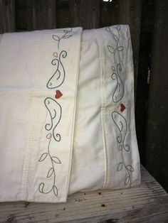 Love Birds  Hand Embroidered Pillow Case set by MyRedbudLeaf on Etsy, $35.00 - cream pillowcases with greens and blues