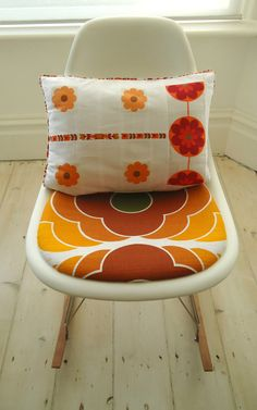 orange pop cushion cover on beautiful chair