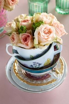 Tea Cups Stuffed with Roses. Stack up dainty details to complete a baby shower table cute and complete.