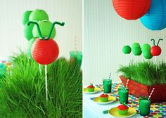 Very Hungry Caterpillar party: DIY caterpillar centerpiece using mini paper lanterns...Love the center piece! Kind of elegant and understated (would probably switch out the red for a worn wooden box) . . . then a colorful runner!