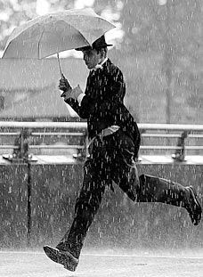 Man in suit running in rain with an umbrella Rain Umbrella, Under My Umbrella, Walking In The Rain, Singing In The Rain, Rainy Night, Rainy Days, Rainy Mood, Rainy Weather, Black White Photos