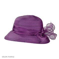 """sur la tete Organza Ribbon Bow Cloche (Purple). Hints of whisper-thin fabric stitched side by side - so simple, so elegant - create the body of the Organza Ribbon Bow Cloche by sur la tete.    The tonal organza trim hugs the crown while a burst of loops and petals asymmetrically leaps off the front of the hat.    4 1/2"""" Round Crown.  2 3/4"""" Brim.    Made of:  100% Polyester Organza    Satin drawstring sweatband.  1-size fits most. (Fits up to size 7 1/8 comfortably.)  $28"""