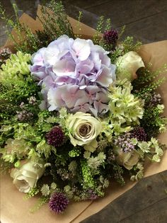 We love these earl grey roses with soft purples and greens