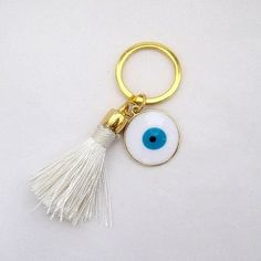 tassel keychain- tassel key chain- evil eye keychain-keychain tassel- tassel-boho keychain-cute keychain-tassel-charm keychain-gift for her- Christening Favors, Baptism Favors, Cute Keychain, Tassel Keychain, First Communion Favors, Yes Band, Diy Jewelry, Unique Jewelry, Hamsa Hand