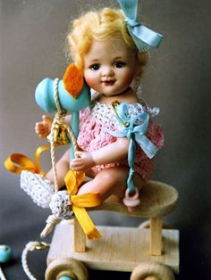 Baby girl porcelain doll by Lorella Falconi