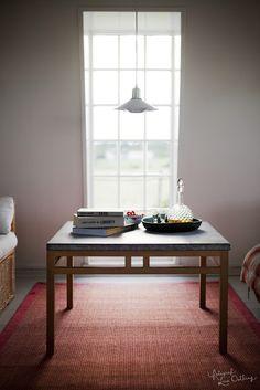 In the mill, livingroom, table, design, big window, summer, coast. Photo: Lina Östling