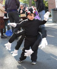Awesome Halloween costume - spider with moveable legs. Idea can be adapted for adults as well. Would be cute to have someone dress up as Miss Muffett as a couple costume