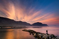 landscape photograph of a fisherman at the bettys bay harbour