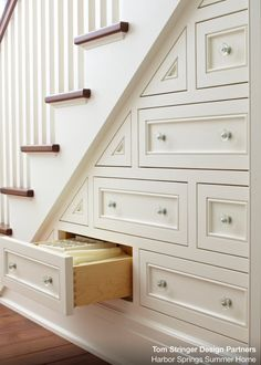 Under staircase storage drawers with style. I love that they are offset.