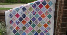 """My Charm Square Quilt is all done and washed.I used three """"Terrain"""" charm packs, """"Snow"""" Kona Cotton for the sashings and100% Hobbs batti..."""