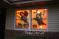 Halloween window scene - with our orange curtains closed behind it would look great.