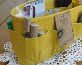 this little shop has some really cute bag organizers.     http://www.etsy.com/shop/DivideAndConquer