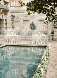 Poolside Wedding Reception with Candles and Greenery lining the edge of the pool creates such a romantic and natural atmosphere for an outdoor wedding
