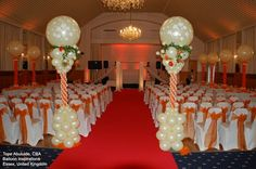 and ivory balloon Columns make a stunning statement at this ceremony. Design by Tope Abulude, CBA, of Balloon Inspirations in Essex, United Kingdom. Wedding Balloon Decorations, Church Wedding Decorations, Balloon Centerpieces, School Decorations, Wedding Balloons, Orange Balloons, Big Balloons, Qualatex Balloons, Balloon Columns