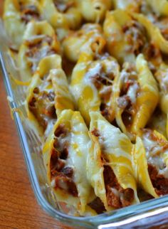 Triple Cheese Barbecue Pork Stuffed Shells start off with pulled pork, spicy barbecue sauce, onions and garlic and end with a creamy three cheese blend.