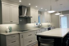This #TransitionalKitchen was designed and built by our team. We're so happy with the final result!  Ready to plan your dream #Toronto #KitchenRenovation, our experts would love to help you, too! Contact us for more information.  📞 Phone: (905) 707-7756 📬 Email: info@josephkitchens.com 📍 Location: 60 Doncaster Ave #2, Thornhill, ON L3T 1L5  #Kitchen #KitchenRenovations #Kitchens #DreamKitchen  #CustomKitchen #KitchenRenovationIdeas  #KitchenCabinets #DreamHomes #DreamKitchens… High End Kitchen Cabinets, Kitchen Cabinet Makers, White Shaker Kitchen Cabinets, White Kitchen Backsplash, High End Kitchens, White Kitchen Island, Kitchen Cabinet Remodel, Transitional Kitchen, Custom Cabinets