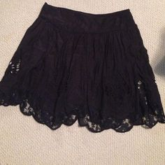 Free people skirt Black skirt with lace panels of overlay. So cute and lightweight! Size small but I am a medium and it still fits me! Free People Skirts Mini