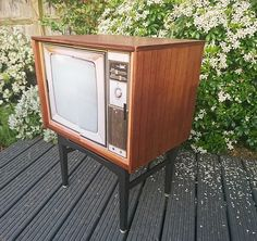 ALREADY SOLD. Mid century drinks cabinet / record storage, restyled with a vintage television image. Made in luxurious Tola wood by Nathan. by HoneyBadgerFurniture on Etsy