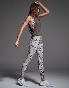boa print leggings & sports bra, open-sided top, pale runners to match leggings