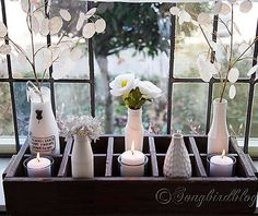 bud vases, tea lights in an evening when the light fades slowly....spring : )