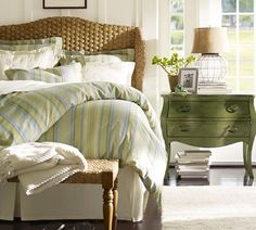 Eclectic bedside tables are fun in a guest room