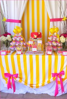 Pink and yellow stripe and curtains - adorable bake sale display idea!