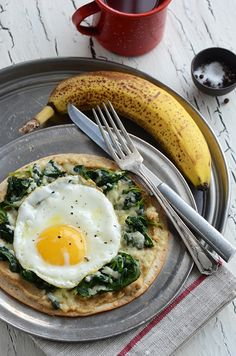 """Breakfast Tostada {With Spinach + Hummus}.  This would be a wonderful """"Breakfast For Dinner"""" for my Shrinking On a Budget Meal plan.  I would tweak it a bit but love the idea"""