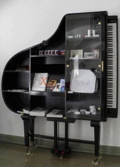 Good use for an old Piano.  Don't you love the way they made use of the legs?