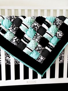 Love the puff-quilt! What a cute baby blanket :)