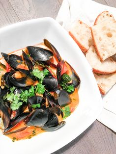 Show off your kitchen skills with this quick and gorgeous appetizer: Thai red curry mussels. Serve with a side of bread for dipping.