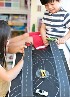 Build a Magnetic Car Race Track for Kids. Fun recycled craft and car DIY play!