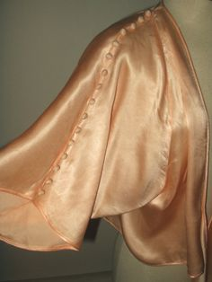 Love the sleeves of this vintage 1920s-1930s silk bed jacket.