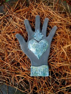 Blue Sacred Heart Raku Wall Hand by terraworks on Etsy