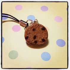A chocolate chip cookie charm! The charm is made out of polymer clay and glazed!     Makes for a perfect decoration for your phone, or your bag! It is approx. 1.8cm in diameter and 0.3cm thick.    If you would like to use it as a phone charm, but do not have the port on your phone to do so, consi...