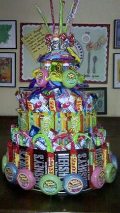 Gift Baskets handmade for him or her and packed with Premium Wine, Chocolates Fruits, Nuts, Beer and more! Gourmet Gift Baskets - Gifts for all Occasions. Candy Birthday Cakes, Candy Cakes, Diy Birthday, Birthday Gifts, Birthday Ideas, Candy Arrangements, Bar A Bonbon, Candy Bouquet, Candy Gifts