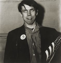 patriotic young man with flag, NY photo by Diane Arbus, 1967